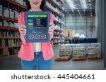 elegant brunette using tablet... | Shutterstock . vector #445404661