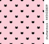 Stock vector seamless pattern of black heads of cats on pink background vector illustration 445433809