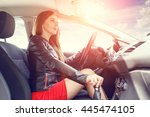 young woman driving a car. fast ... | Shutterstock . vector #445474105