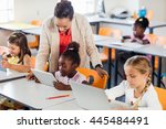 teacher giving lesson to her... | Shutterstock . vector #445484491