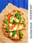 rucola pizza on wrinkled craft... | Shutterstock . vector #445509187