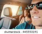 long journey in car with daddy | Shutterstock . vector #445553191