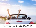 young men drive a car on the... | Shutterstock . vector #445565995