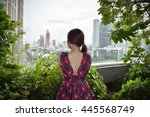 woman looking at city   Shutterstock . vector #445568749