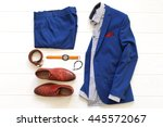 Stock photo flat lay set of classic men s clothes such as blue suit brown shoes belt watches and bracelet on 445572067