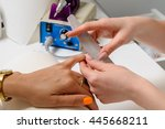 manicurist at her job | Shutterstock . vector #445668211
