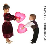 Little girl and boy with red heart-like balloons - stock photo