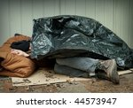 Homeless Man Curled Up Under A...