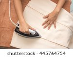 woman ironing clothes on... | Shutterstock . vector #445764754