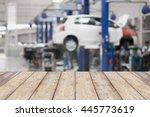 wood table top with blur garage ... | Shutterstock . vector #445773619