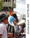 Small photo of COTACACHI, ECUADOR - JUNE 29, 2016: Inti Raymi, the Quechua solstice celebration, with a history of violence in Cotacachi. Man in an American Indian costume dances in the circle.
