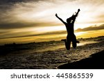young girl jumping on the beach  | Shutterstock . vector #445865539