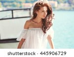 Young attractive woman near the lake on a summer day