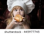 little girl eating cake  suit... | Shutterstock . vector #445977745