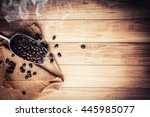 coffee bean on grunge wooden... | Shutterstock . vector #445985077