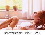 pretty woman relaxing in the... | Shutterstock . vector #446021251