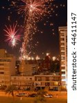 Beautiful night scene celebration of new year with fireworks over the buildings. Montevideo, Uruguay - stock photo