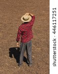 Farmer With Hat Standing On...