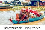 Small photo of Tonle Sap Lake Siem Reap, Cambodia - July 13, 2013: Cambodian people live on Tonle Sap Lake in Siem Reap, Cambodia. Mother with the children in the boat