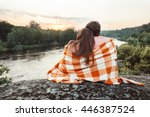 loving couple wrapped in plaid... | Shutterstock . vector #446387524