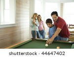 Man And Boy Shooting Pool With...