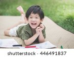 Cute Asian Child Drawing...