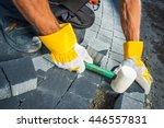 cobble brick paving works. men...   Shutterstock . vector #446557831