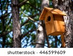 Wooden Birdhouse On A Tree In...