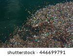 floating garbage in polluted ... | Shutterstock . vector #446699791