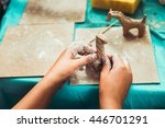 Children's Hands Sculpts Clay...