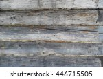 A Wall Of Thick Wooden Logs An...