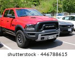 Small photo of ANCASTER, CANADA - JULY 3, 2016: Red pick-up truck parked in a restaurant car park. Ancaster is located on the Niagara Escarpment that amalgamated with the city of Hamilton, Ontario, Canada in 2001.