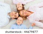 portrait of happy family lying... | Shutterstock . vector #44679877