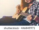 Young Hipster Woman Playing A...