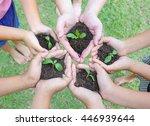 hands holding sapling in soil... | Shutterstock . vector #446939644