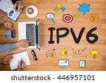 Small photo of IPV6 Internet Protocol larger address space Business team hands at work with financial reports and a laptop