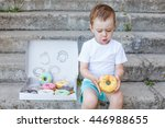 Child Sitting On The Steps Wit...