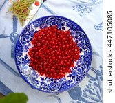Small photo of red currant on a plate/ red currant/ red currant on a plate