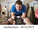 man on exercise bike in a... | Shutterstock . vector #447117871