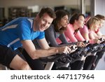 man in a spinning class at a... | Shutterstock . vector #447117964