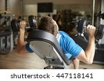 man works out with dumbbells on ... | Shutterstock . vector #447118141