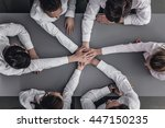business people joining hands... | Shutterstock . vector #447150235