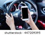 woman driver using smart phone... | Shutterstock . vector #447209395