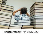 a kid in library reading books | Shutterstock . vector #447239227