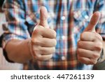 Small photo of good hand, good job , man show thump up for agreement sign with success business concept.