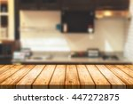 wood desk space and blurred of... | Shutterstock . vector #447272875