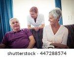 seniors interacting with nurse... | Shutterstock . vector #447288574