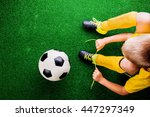 unrecognizable little football... | Shutterstock . vector #447297349