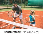practicing tennis. cheerful... | Shutterstock . vector #447314374