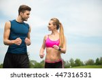 cheerful two runners jogging... | Shutterstock . vector #447316531